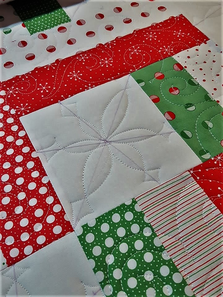 Christmas quilt with a snowflake and swirl motif